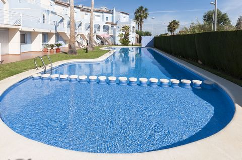 Fantastic 3 storey house in Oliva Nova, located in a beautiful and family complex of terraced houses with a shared pool. It can comfortably accommodate from 6 to 9 guests. The great salted pool is surrounded by a simple but well cared garden, what ma...