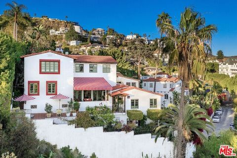Walled, gated, perched above Sunset Blvd, surrounded by celebrity neighbors, this enchanting 1927 Spanish has jetliner views from every room. Built and home to the builder of the Hollywood Bowl, this home is impeccably preserved, updated, maintaining...