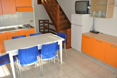 Residence with pool and garden in the luxurious area of Terra Mare in Lignano Sabbiadoro. Ground floor apartment consists of spacious living room, kitchenette with oven and large big terrace with table and chairs, double bedroom, bedroom with bunk be...