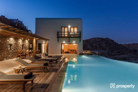 Located overlooking the stunning waters of Psarrou beach in Mykonos, and a short stroll to the coveted Nammos Beach Bar, we present the most perfect blend of elegance with gently rustic materials enhanced by rich earth tones of this traditional Cycla...