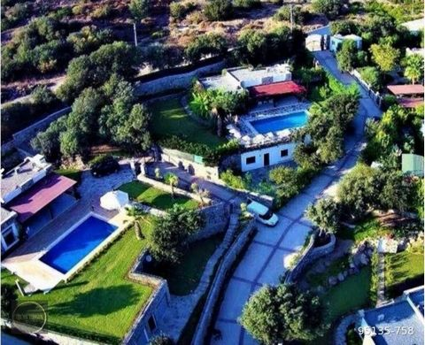 In Bodrum Gümüşluk, in the nature of the authentic fishing village, it is designed with 10 fully detached private pools in an area of 20,000 m2 with calm, peaceful, valley and Kos View. Although it is designed as a site, villas are independent of eac...