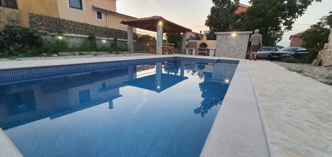 Location: Primorsko-goranska županija, Dobrinj, Gabonjin. We are selling a house with two apartments in Gabonjin on the island of Krk. Each apartment consists of two bedrooms, bathroom, kitchen and living room. The area of each apartment is 75 m2, ...