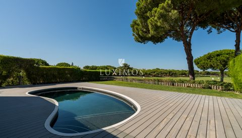 Real estate property with pool  facing a  golf course,   for sale in Vilamoura , in the Algarve in Portugal. Fully renovated property by the use of modern and first quality materials,  with solar orientation to the south. The property is comprised of...