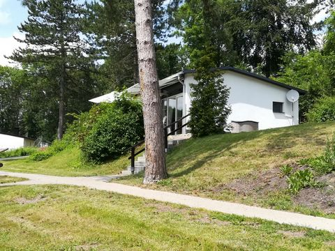 This apartment is situated in a peaceful holiday park on the south side of Vobbenberg. Each bungalow offers a magnificent view of the valley with its villages of Husen and Atteln. The park has various events which ensure that you will not be bored. T...