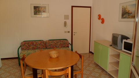 Apartment in quiet area, 300 mt. from the sea with private garden and parking. Well furnished apartment with spacious living room with kitchenette and double sofa bed, double bedroom and bathroom with shower. Terrace with table and chairs. Washing ma...