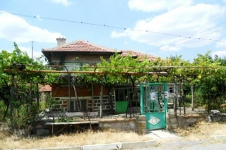 The property consists of a solid built 2-storey house, some farm buildings, massive concrete built garage and a huge plot of land spreading over 3000 sq.m. Half of the garden is planted with orchards watered by a private water source (a well with spr...