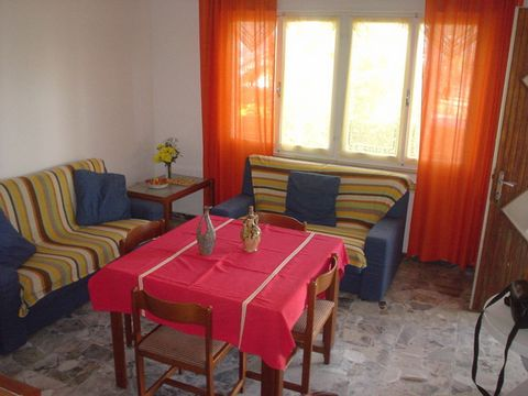 Two family villa situated in a pleasant and peaceful place near to the beach, only few steps away from shops and supermarket, perfect for families with children. The villa is composed by a big and bright living room with kitchenette, 1 double room, 1...